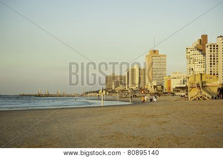 Panoramic View Of Tel-aviv Beach On A Morning With Tourists Behind