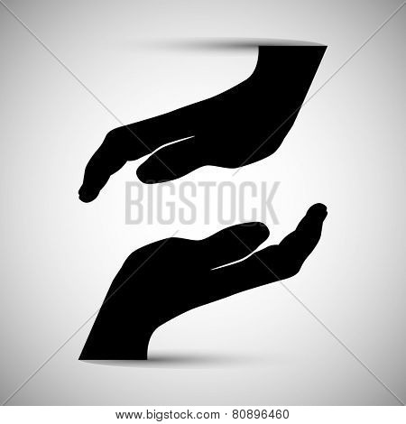 An image of two silhouette hands coming together.