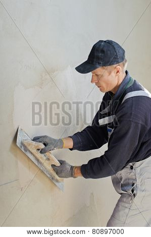 Man Gets Manually Gypsum Plaster