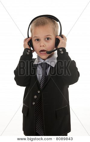 A Small Boy Pretending To Be A Businessman.