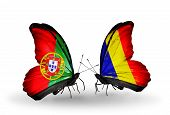 stock photo of chad  - Two butterflies with flags on wings as symbol of relations Portugal and Chad Romania - JPG