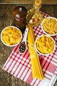 stock photo of spaghetti  - Different kinds of italian pasta like a fusilli farfalle spaghetti and penne pasta