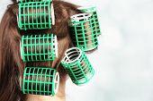 foto of hair curlers  - Long female hair during hair dressing with curler - JPG