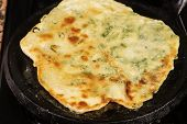 picture of pancake flip  - Making scallion pancakes - JPG