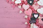 pic of shabby chic  - Romantic heart shape pink white and black cookies and candy background on vintage shabby chic pink wood table with copy space overhead - JPG