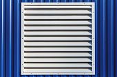 stock photo of jalousie  - White window with jalousie in blue color metal siding wall - JPG