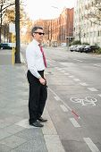 image of blind man  - Portrait Of A Blind Mature Man Crossing Road Holding Stick - JPG