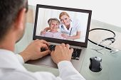 picture of video chat  - Doctor Having Video Conference With Senior Patient And Nurse - JPG