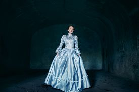 foto of dungeon  - Woman in victorian dress imprisoned in a dungeon