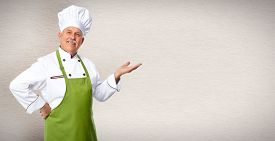picture of dinner invitation  - Senior professional chef man over grey wall background - JPG
