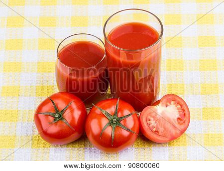Tomatoes  And Juice In Glass On Tablecloth