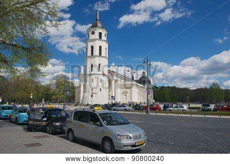 Taxi cabs wait in line at the Cathedral square in Vilnius, Lithuania.