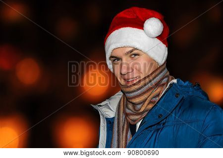 The Young Man In A Santa Hat