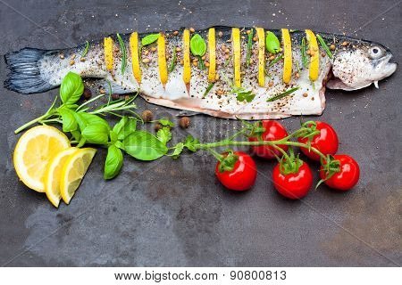 Lemon Stuffed Trout With Spices On The Tray