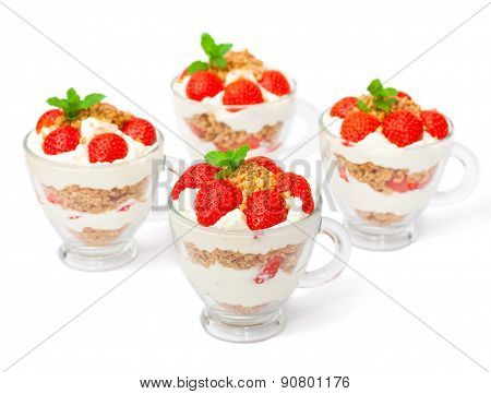 Homemade Desert With Cream Chopped Cookies And Fresh Strawberry On White