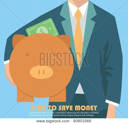 Businessman holding piggy bank