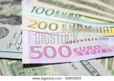 Background of euro and dollar bills. Shallow focus.