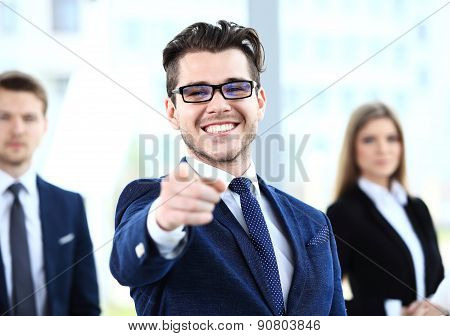 Handsome Man Pointing His Finger At You On The Background Of Business People