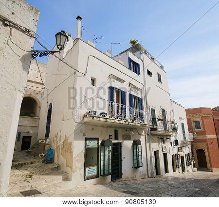 White Houses In A Street In Ostuni, Puglia, Italy