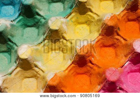 Colorful egg cardboard carton painted diagonal