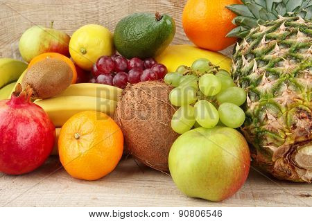 Group Of Various Fruits On Wooden Plank