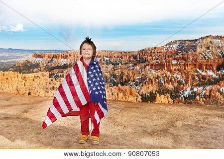 Boy wears USA flag, celebrating 4th July