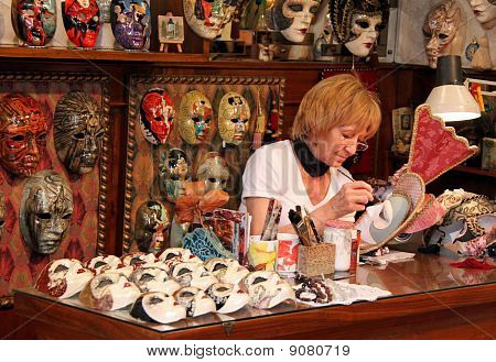 The owner of a papier mache art shop