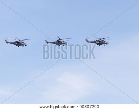 Mi-35 Flying Formation On The Blue Sky