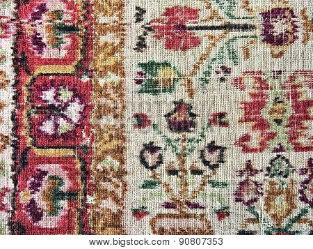 Old Faded Carpet With Floral Ornament Closeup