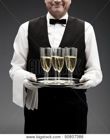butler serving champagne