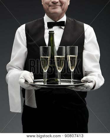 butler with three champagne flutes