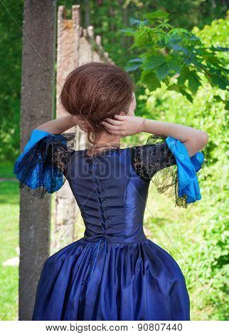 Beautiful Woman In Blue Medieval Dress Outdoor, Back