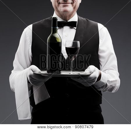 butler with wine bottle