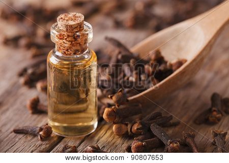 Clove Oil Macro On An Old Desk. Horizontal