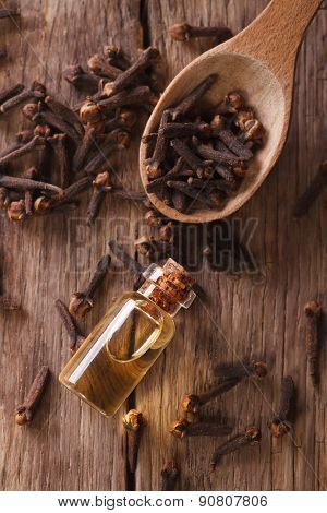 Essence Of Cloves In The Bottle Macro  Vertical Top View
