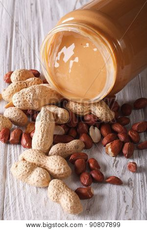 Peanut Butter In A Glass Jar And Nuts Vertical