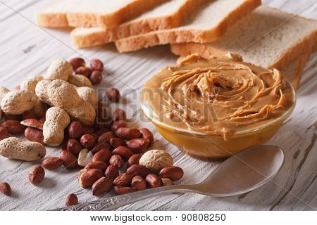 Peanut Butter In A Bowl Close-up On A Table Horizontal