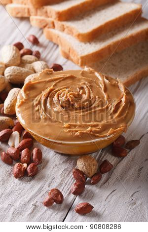 Peanut Butter In A Bowl Close-up On A Table Vertical