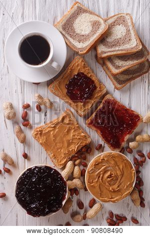 Sweet Sandwiches With Jelly, Peanut Butter And Coffee Top View