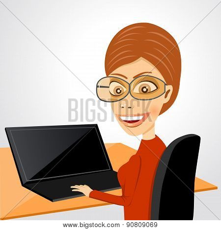 secretary sitting at table with laptop
