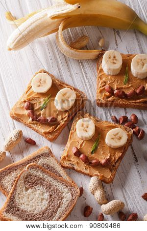 Children Sandwiches With Peanut Butter And Banan Top View