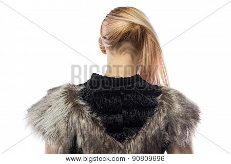 Photo of woman in fake fur jacket,  turned back