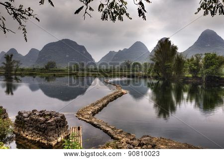 Dam On River Yulong, Amid Karst Hills, Guilin, Guangxi, China.