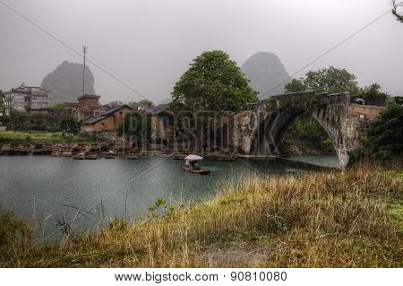 Dragon Bridge On Yulong River, Yangshuo, Guilin, Guangxi Province, China.