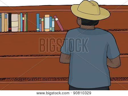 Male In Hat Browsing Books