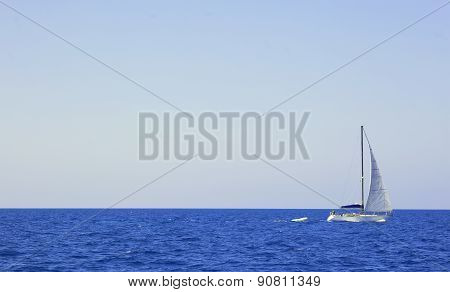 Sailboat On Vast Blue Ocean