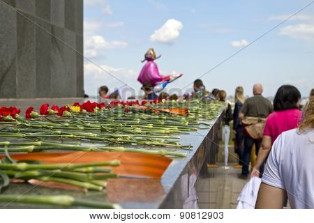 Laying Red Carnations At The Foot Of The Sculpture Of The Motherland Is Calling Mamayev Kurgan