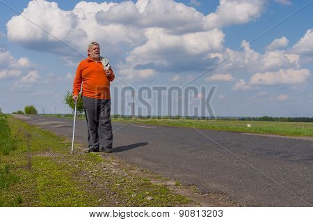 Senior man walking on the country road