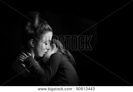 Mother Hugging Daughter Tenderly