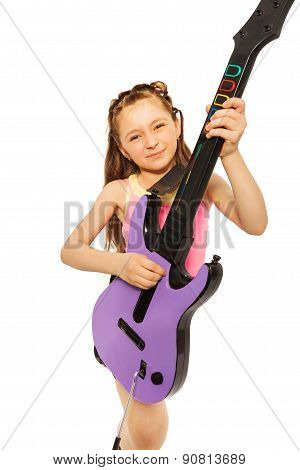 Close-up view of girl playing on electro guitar